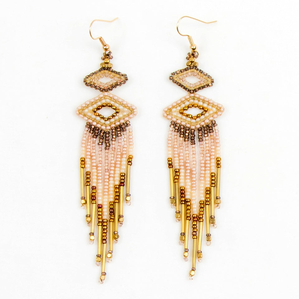 Beaded earrings with a small beaded wide diamond shape at top, a medium diamond shape below and danging beaded fringe below that. Colors: gold, bronze and cream. Earrings have hooks.