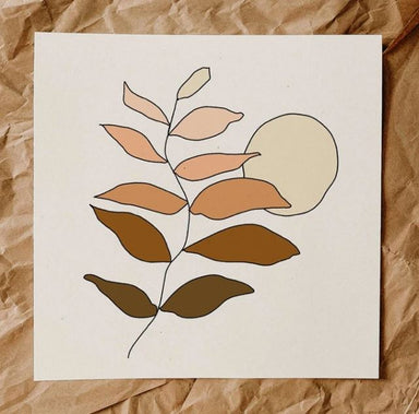 A dainty line drawing of a branch, placed vertically on the print, dark brown leaves at the bottom fade into peach tones at the top. An assymetrical, pale yellow sun is behind it. White background.