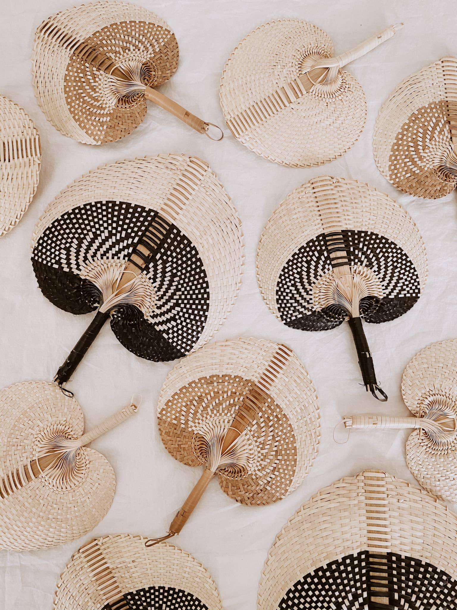 The Paradisio Woven Hand Fan by Village Thrive