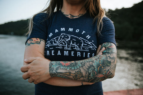 Mammoth Creameries tee shirt with arms crossed