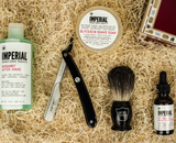 Imperial Glycerin Face/Shave Soap, Imperial Pre-Shave Oil, Parker PTB Barber Razor (barbershop style with steel arm and push-style blade holder to swap fresh blades), Parker Black Badger Brush Imperial Bergamot After-shave, all in the Broquet Straight Razor Kit.