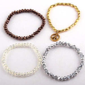 Glass crystal silver yellow brown beads and gold pipe beads with peace charm 4 string bracelet one set