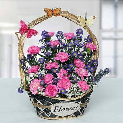 Delightful Carnations N Blue Aster Flower Basket