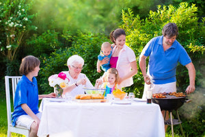 A family having a barbecue on the garden on a bright day