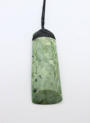 Bound Pounamu Toki with etching