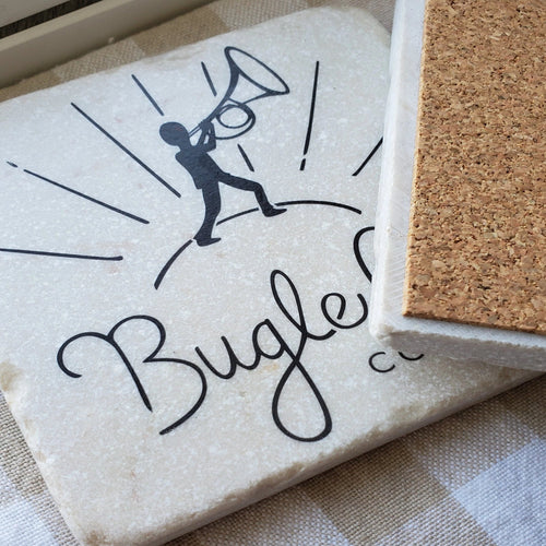 Handcrafted stone coaster with Bugle Call Coffee logo and cork backing