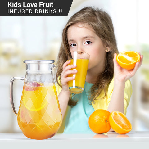 glass pitcher with orange drink
