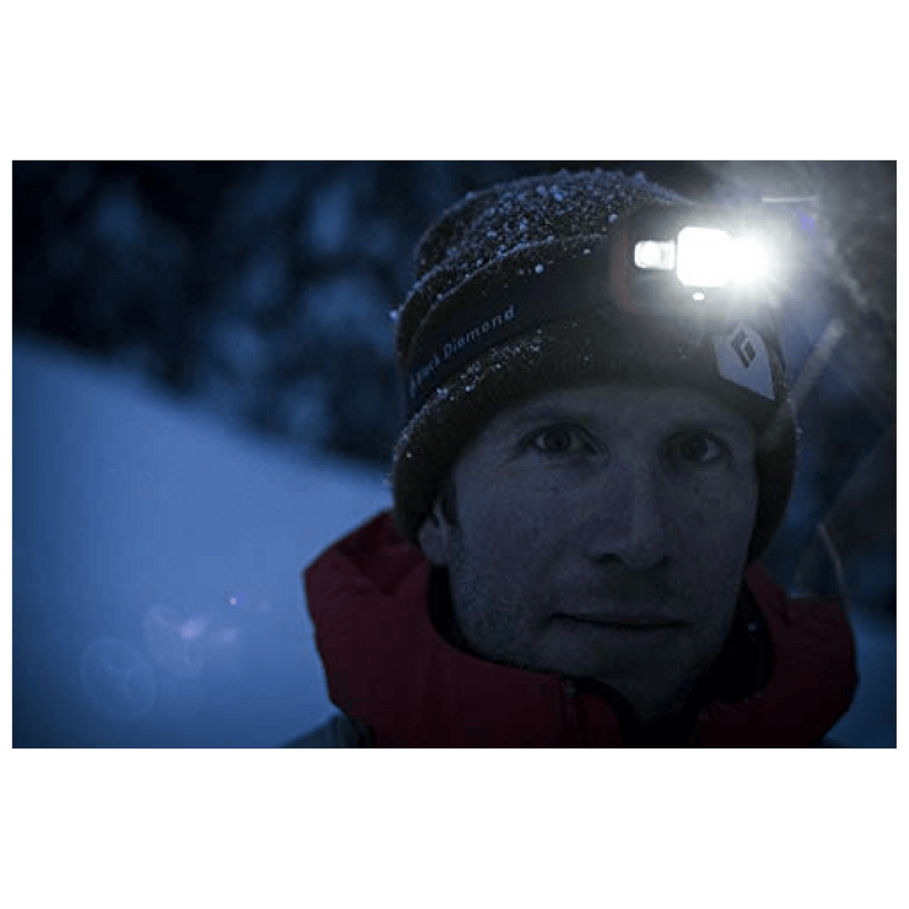 """Man wearing a Black Diamond STORM Headlamp in Winter"""