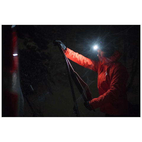 """Man using Black Diamond STORM Headlamp during Winter"""