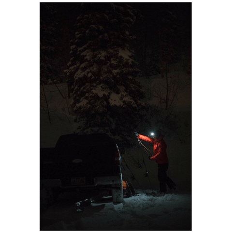 "Image of ""Fixing the car with Black Diamond STORM Headlamp in snowy night"""