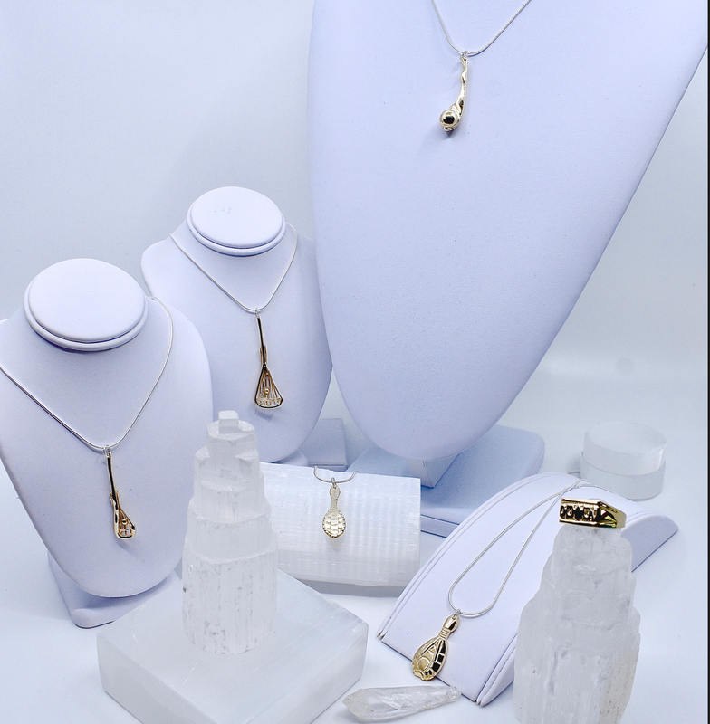 The TRADITIONS gold collection is inspired by traditional arts, sport & practices of the Haudenosaunee (Iroquois) people.