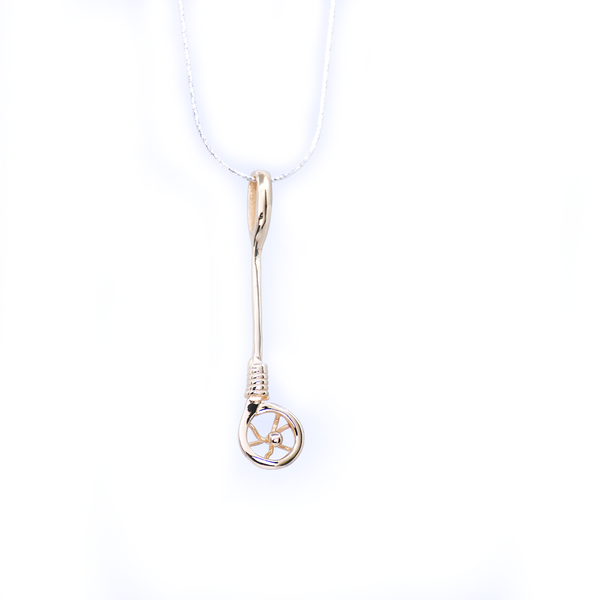 10kt gold Stickball pendant