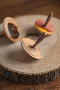 Spin top made from recycled skateboards