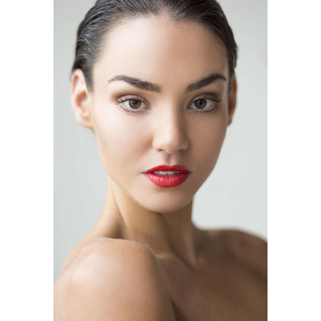 Model wearing Aurora red lipstisck