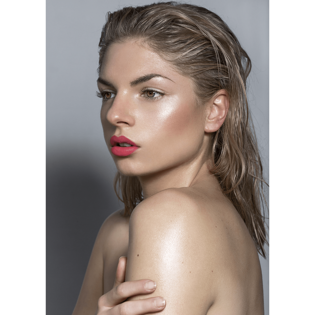 Model wearing Lou Lou Lips William coral peachy pink lipstick