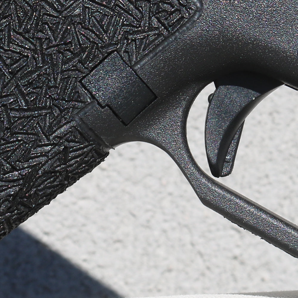 A single cut under the trigger guard where your middle finger rest. Prevents blistering, and aids in a higher grip on the firearm