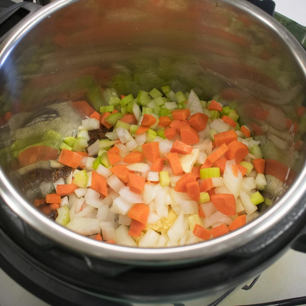 Add the onions, carrots, garlic and celery