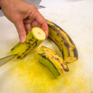 Cut the peels off the plantains and cut into chunks