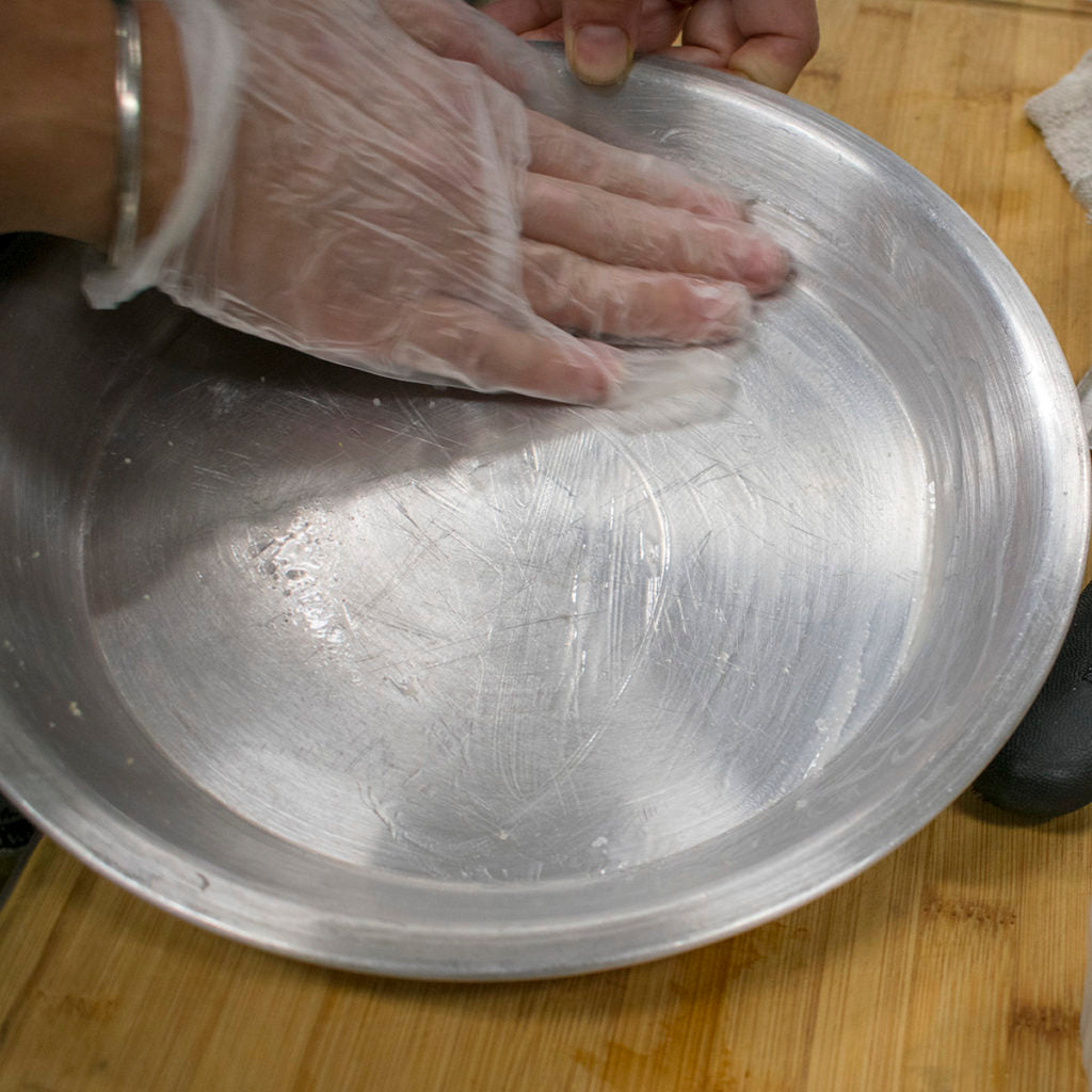 Grease a 9'' round cake pan with coconut oil