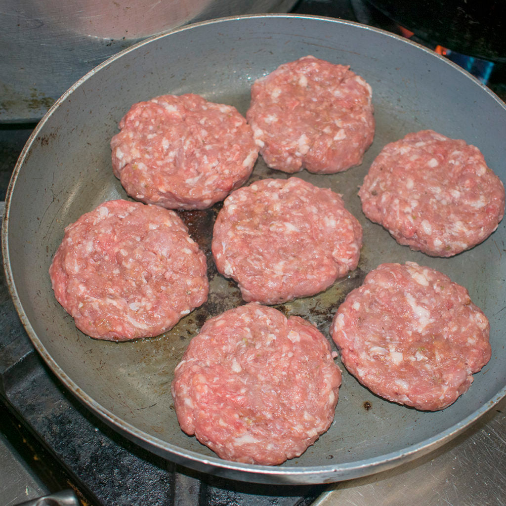 Fry the AIP Brats in a little bacon fat or lard in a skillet