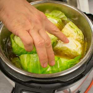 Place cabbage into the pressure cooker and cook for 5 minutes