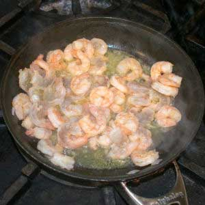 Cook the shrimp in a pan until pink