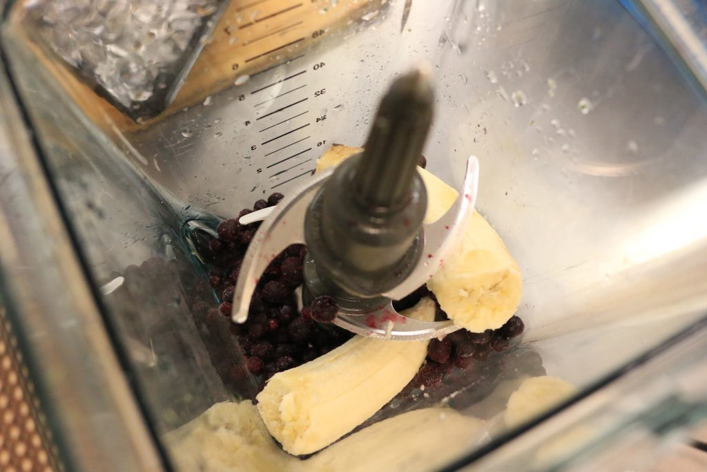 Add blueberries and banana to blender