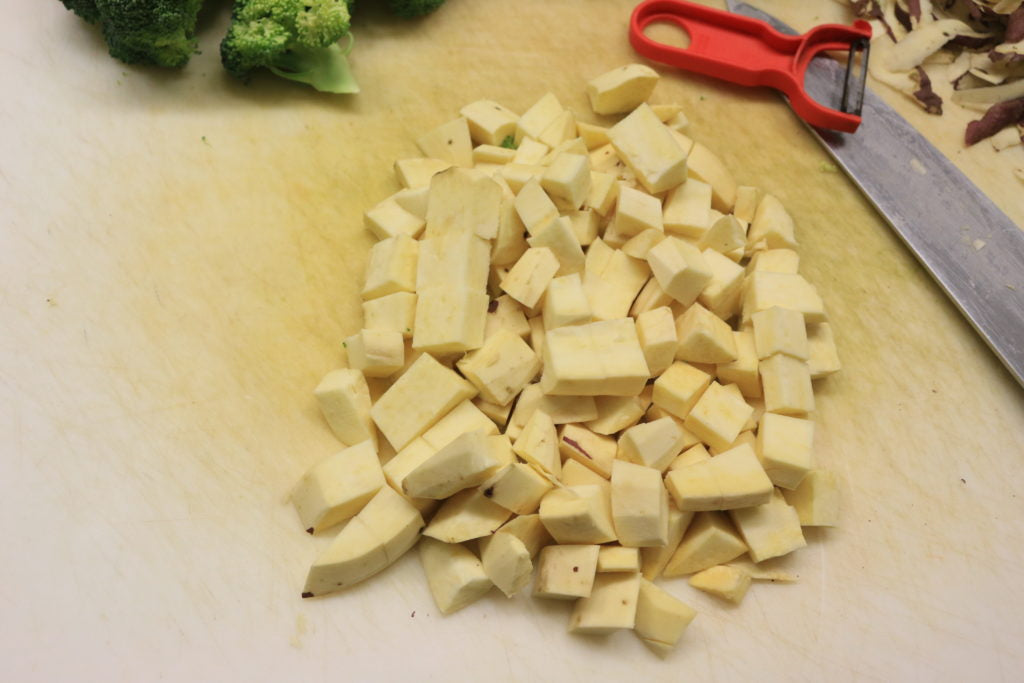Peel and chop potatoes into 1 inch cubes