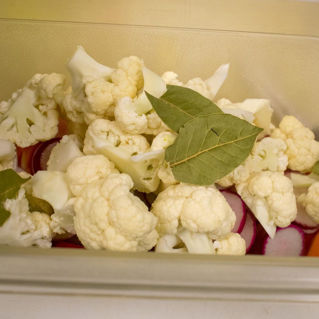 Put cauliflower and bay leaves in