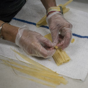 Pull a thin strip off one of the husks to make a string
