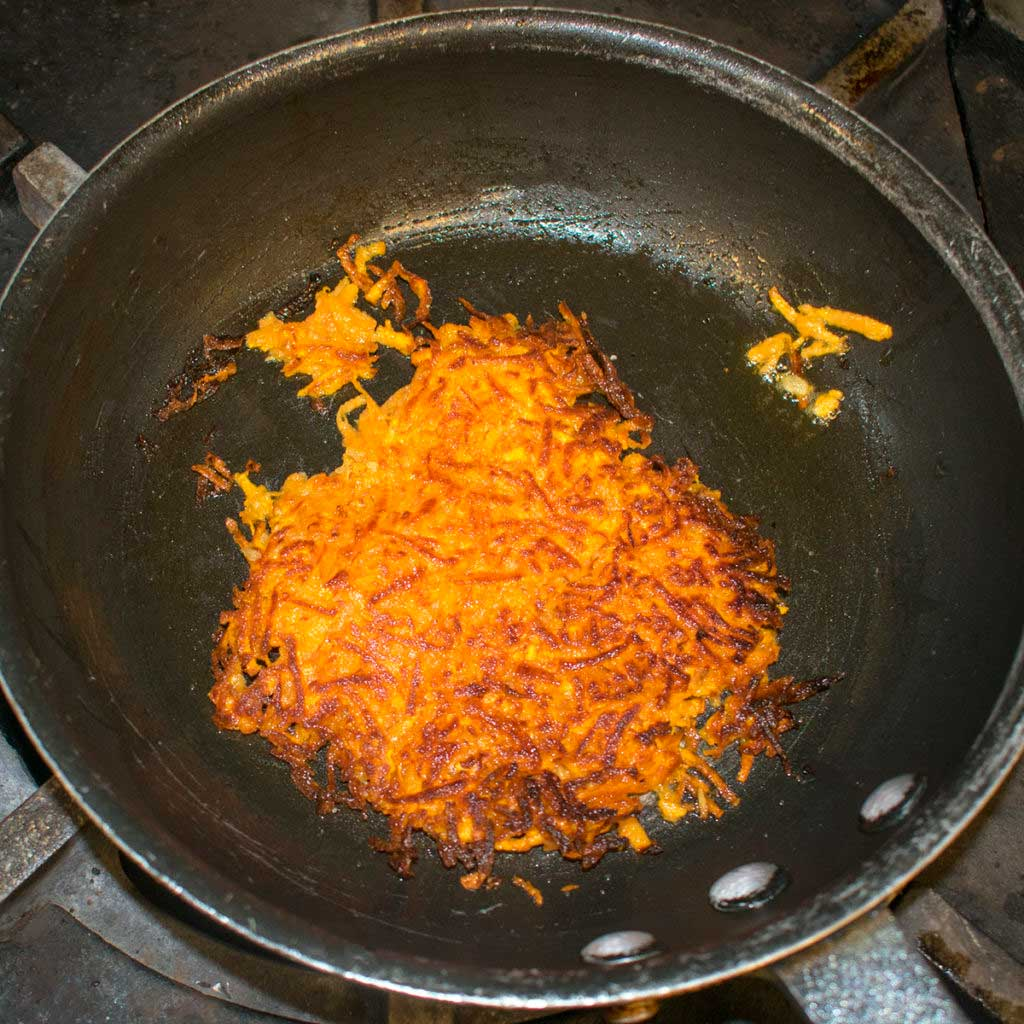 cook aip hashbrowns until golden brown