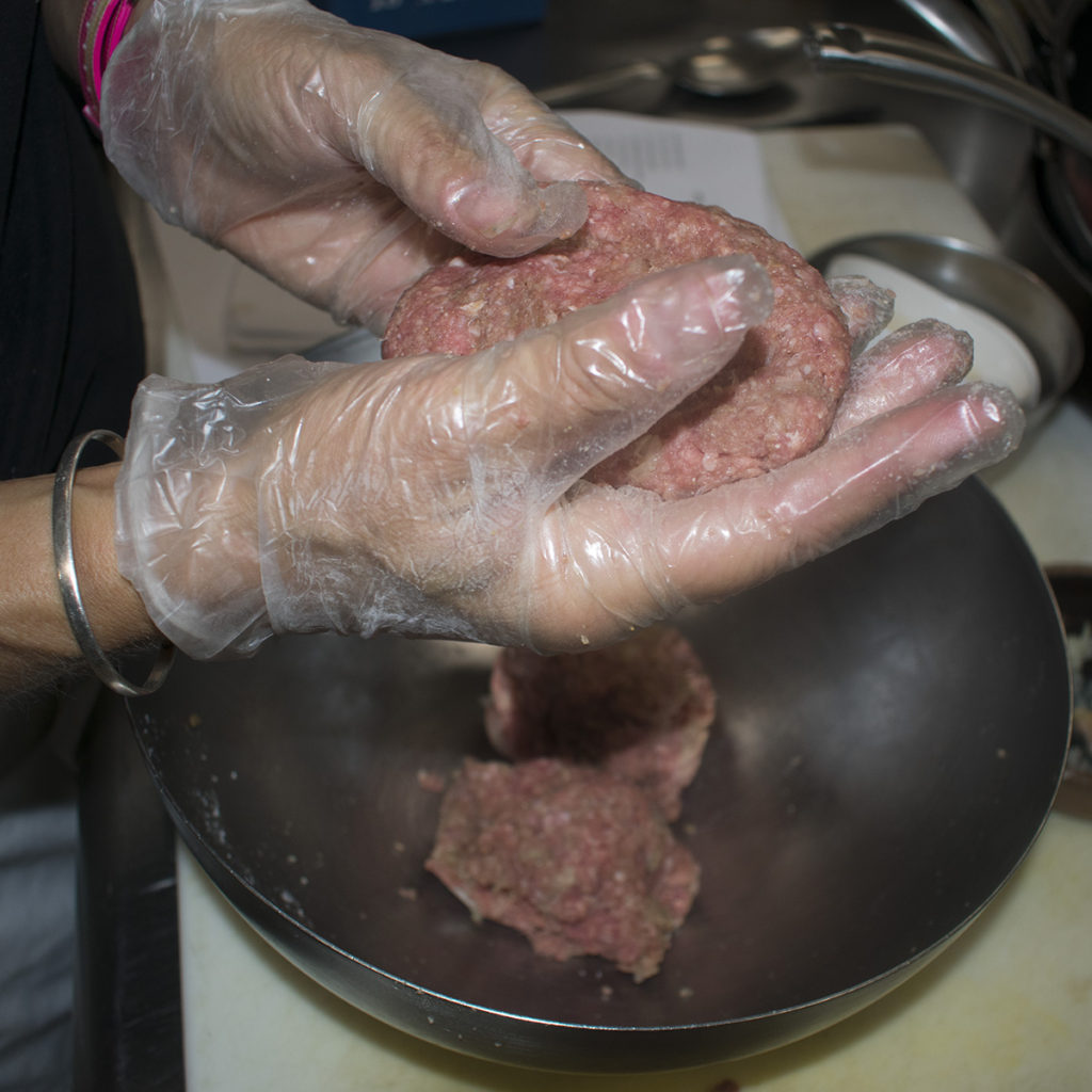 Divide the beef mixture into four equal size portions and form into patties about 1/2 inch thick