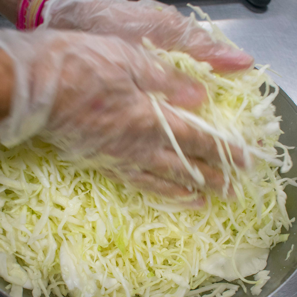 Combine the cabbage and salt.