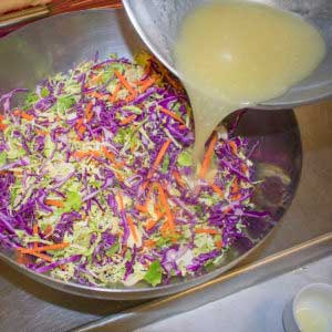 Whisk in oil to combine dressing