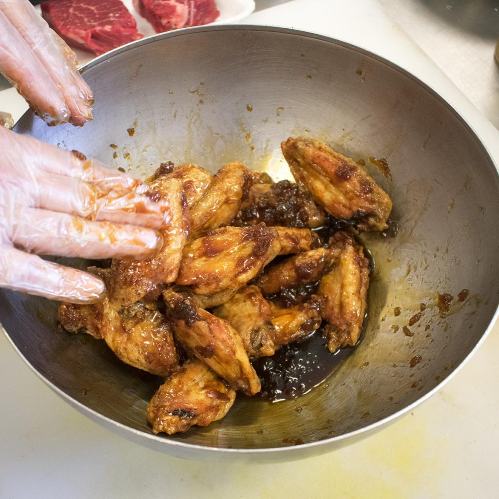 toss aip chicken wings to coat