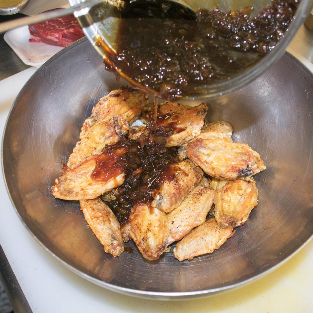 Place cooked wings in a large bowl, add the sauce.