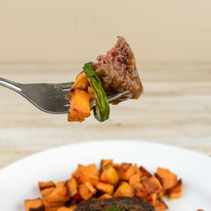 fork of paleo burger and veggies