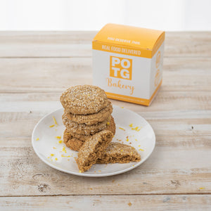 box of paleo lemon cookies with sprinkled coconut