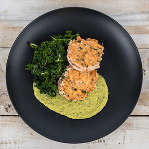 Zesty Salmon Burgers with Avocado Sauce and Sautéed Kale