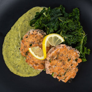zesty salmon burgers with avocado sauce and sauteed kale