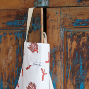 coral print apron close up