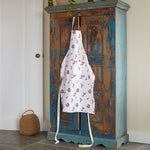 coral print apron hanging over cupboard in kitchen