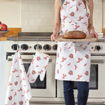 coral print apron , coral print oven glove and coral print tea towel in the kitchen