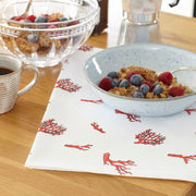coral tea towel granola  breakfast setting on the kitchen salad.
