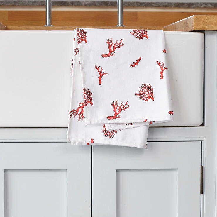 Coral print tea towel on kitchen sink