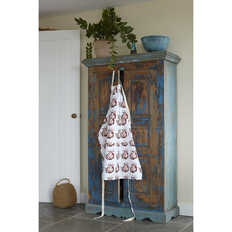 crab print apron hanging over a cupboard door