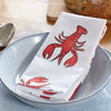 Lobster napkin on blue plate on a dinning table
