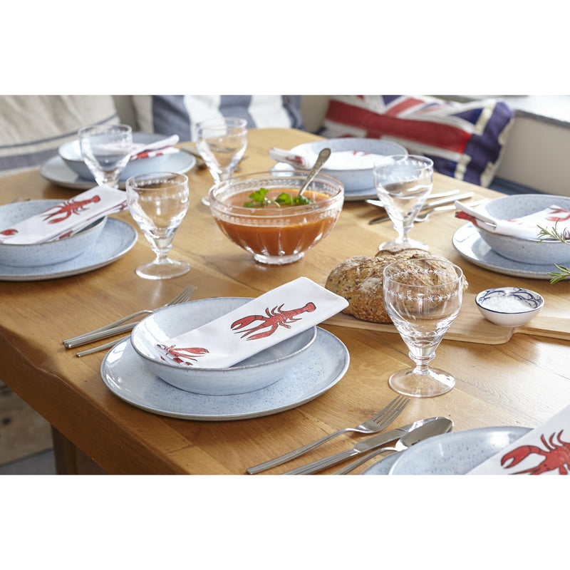Lobster napkin table setting on wooden table in the ktichen