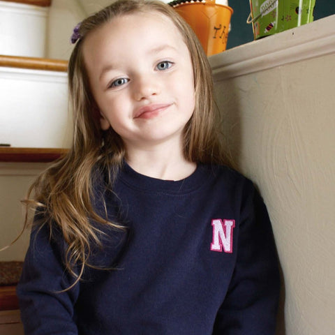 Monogrammed varsity initial unisex crewneck sweatshirt. Personalized with collegiate two-tone initial. Monogrammed shirt for kids. Personalized crewneck sweatshirt for kids.