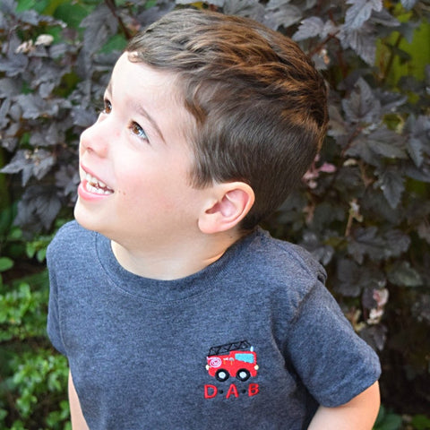 Custom monogrammed firetruck tee personalized with name or monogram. Boy birthday party shirt, custom vehicle kids tshirt by Stitch monograms Chicago.